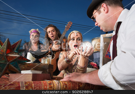 Embarrassed Crystal Ball Reader stock photo, Embarrassed group of people reading a crystal ball by Scott Griessel