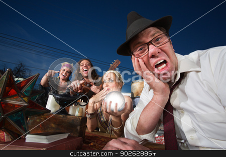 Upset Man with Crystal Ball stock photo, Embarrassed white businessman next to giggling fortune teller by Scott Griessel