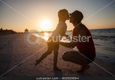 Mom and daughter silhouette in the sunset at the beach on Holbox island stock photo, Mom and daughter silhouette in the sunset at the beach on Holbox island by Dmitry Travnikov