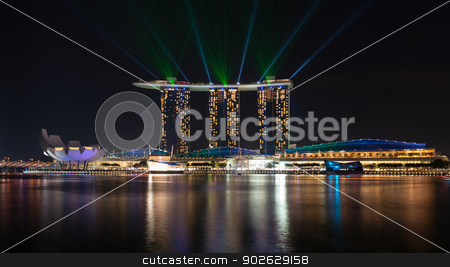 Singapore famous hotel of Marina Bay Sands complex on sunset stock photo, SINGAPORE - JUN 1: Laser show on Marina Bay Sands complex skyline at night on Jun 1, 2013 in Singapore. It is an integrated resort became a  symbol of modern Singapore. by Iryna Rasko