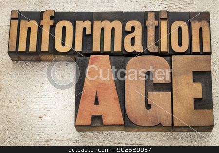 information age in wood type stock photo, information age  in vintage letterpress wood type on a grunge painted barn wood background by Marek Uliasz