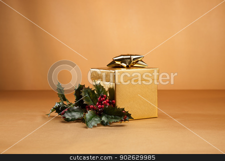 Gold present and holly stock photo, Gold present and holly isolated over gold by Ulrich Schade