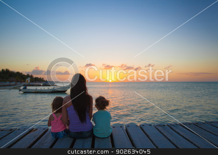 Mom and daughters silhouette in the sunset on the bridge stock photo, Mom and daughters silhouette in the sunset on the bridge by Dmitry Travnikov