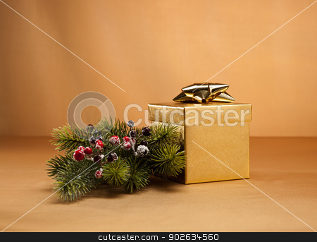 Gold present  stock photo, Gold present in Christmas setting for many events by Ulrich Schade
