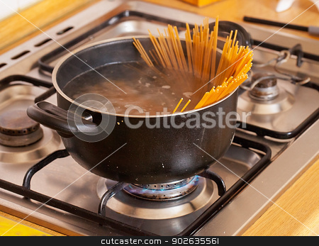 Pasta stock photo, A pot with boiling water and spaghetti by Fabio Alcini
