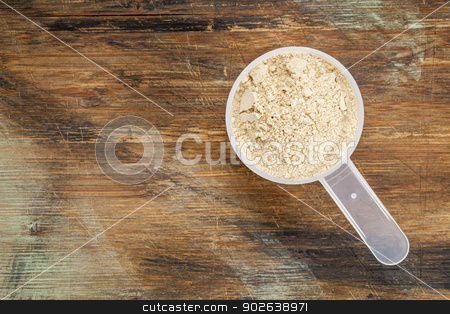 maca root  powder stock photo, measuring scoop of maca root  powder - top view against painted wood background by Marek Uliasz