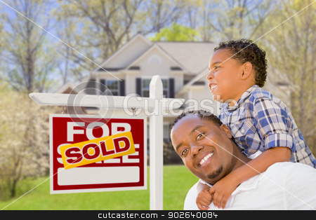 Mixed Race Father and Son In Front of Real Estate Sign and House stock photo, Happy Mixed Race Father and Son In Front of Sold Real Estate Sign and New House. by Andy Dean