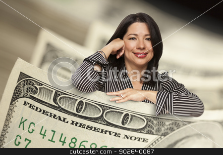 Hispanic Woman Leaning on a One Hundred Dollar Bill stock photo, Attractive Hispanic Woman Leaning on a One Hundred Dollar Bill. by Andy Dean