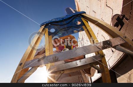 Graffiti Artist Framed By Ladder stock photo, Graffiti artist framed by ladder and working on mural by Scott Griessel
