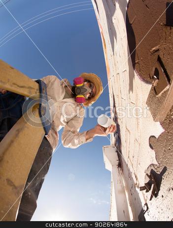 Graffiti Artist Using Spray Paint stock photo, Wide angle view of graffiti artist on ladder making a mural by Scott Griessel