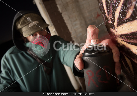Criminal Holding Up Spray Can stock photo, Black spray paint can held by anonymous criminal by Scott Griessel