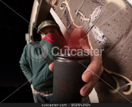 Man with Hood and Spray Paint stock photo, Man with hood and face covering holding spray paint can by Scott Griessel