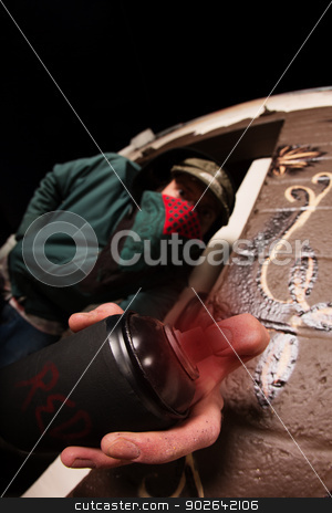 Man with Mask and Spray Paint Can stock photo, Man hiding behind face mask with spray paint can by Scott Griessel