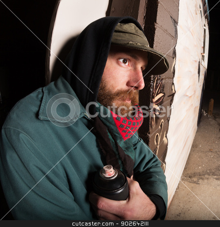 Gangster with Spray Paint stock photo, Gang member with spray paint can leaning against wall by Scott Griessel