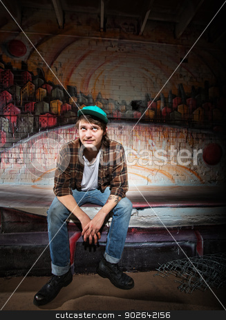Indifferent Teenager stock photo, Indifferent young homeless teenager sitting outside by Scott Griessel