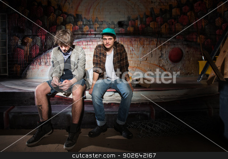 Two Bored Youth stock photo, Two bored homeless white teenagers sitting outside by Scott Griessel