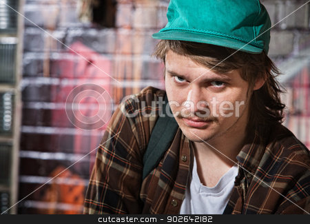 Suspicious Male with Hat stock photo, Suspicious unemployed European male with hat by Scott Griessel