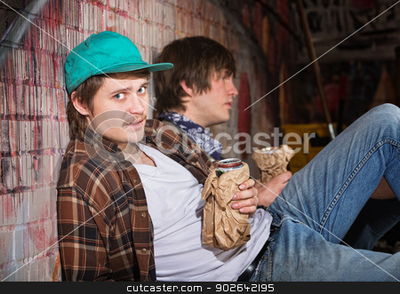 Drunk Young Men stock photo, Two drunk young European men sitting outside by Scott Griessel