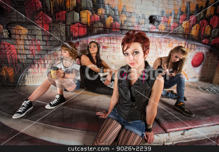 Bored Woman with Friends stock photo, Beautiful young woman bored with friends behind her by Scott Griessel