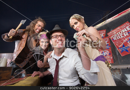 Man Gives Money to Fortune Tellers stock photo, Naive businessman giving money to group of fortune tellers by Scott Griessel