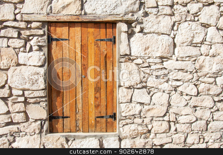 Closed wooden window and shutters in stone wall stock photo, Closed wooden window and shutters in natural stone wall by Catharina van der Veen