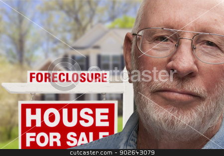 Depressed Senior Man in Front of Foreclosure Sign and House stock photo, Depressed Senior Man in Front of Foreclosure Real Estate Sign and House. by Andy Dean