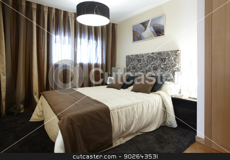 Bedroom stock photo, A modern bedroom brown tone decoration horizontal by ABBPhoto