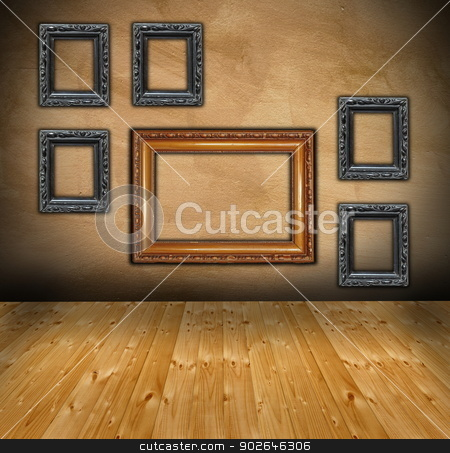 wall with composition of empty frames stock photo, interior with wooden floor and wall with frames in an abstract composition ready for your design by coroiu octavian