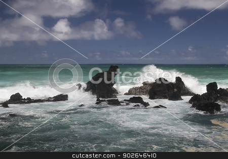 Raging waves stock photo, volcanic rock formation being pounded by wave by Yann Poirier