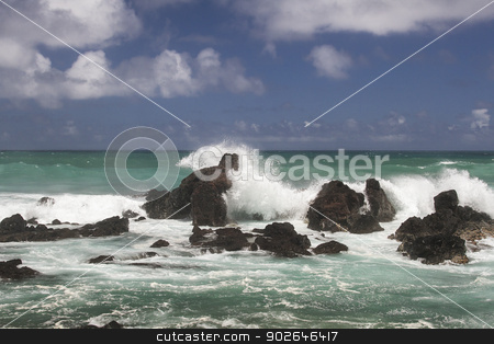 Rock formation stock photo, volcanic rock formation being pounded by wave by Yann Poirier