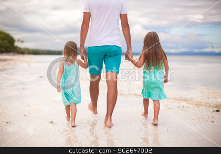 Rear view of father and his two kids walking by the sea stock photo, Rear view of father and his two kids walking by the sea by Dmitry Travnikov