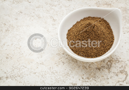 organic noni powder stock photo, organic noni fruit powder in a small bowl against a ceramic tile background by Marek Uliasz