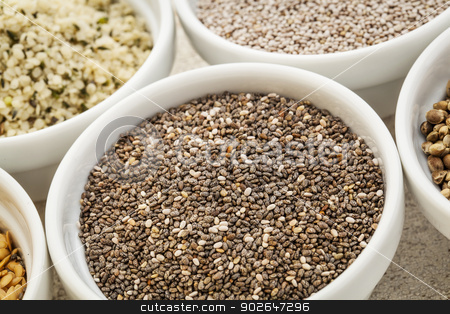 chia seeds stock photo, chia seeds in a white ceramic bowl among other healthy seeds by Marek Uliasz