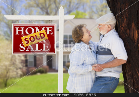 Sold Real Estate Sign with Senior Couple in Front of House stock photo, Sold Real Estate Sign with Happy Affectionate Senior Couple Hugging in Front of House. by Andy Dean