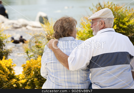 Happy Senior Couple on Bench in The Park stock photo, Happy Senior Couple on a Bench Enjoying Each Other in The Park. by Andy Dean