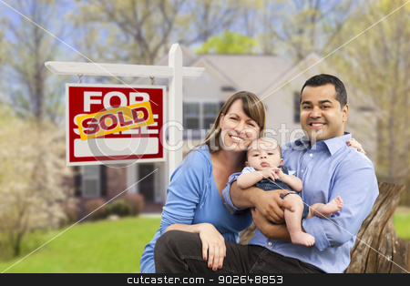 Young Family in Front of Sold Real Estate Sign and House stock photo, Happy Mixed Race Young Family in Front of Sold Home For Sale Real Estate Sign and House. by Andy Dean