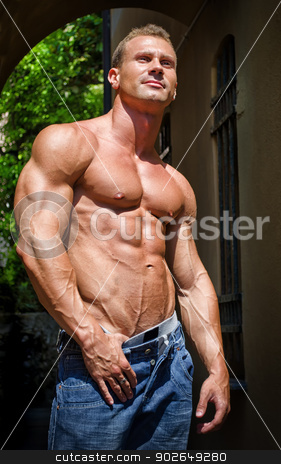 Attractive and muscular male bodybuilder shirtless stock photo, Attractive and muscular male bodybuilder shirtless in jeans smiling by Stefano Cavoretto