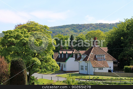 English village stock photo, Scenic view of green houses in green countryside, England. by Martin Crowdy