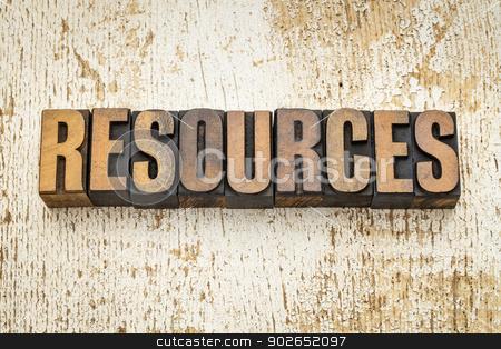 resources word in wood type stock photo, resources  word in vintage letterpress wood type on a grunge painted barn wood background by Marek Uliasz