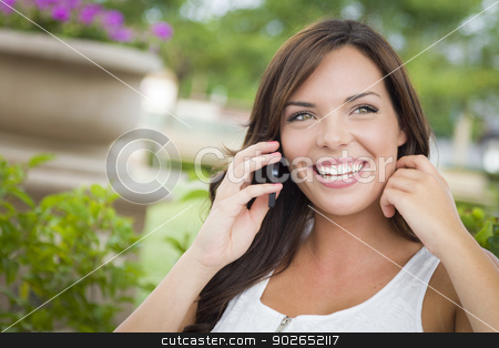 Young Adult Female Talking on Cell Phone Outdoors on Bench stock photo, Attractive Young Adult Female Talking on Cell Phone Outdoors on Bench. by Andy Dean