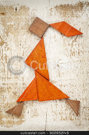 tangram walking girl figure stock photo, abstract figure of a walking or running girl built from seven tangram wooden pieces, a traditional Chinese puzzle game; rough white painted barn wood background by Marek Uliasz