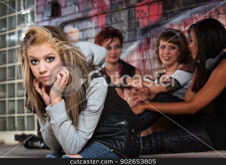 Disappointed Female Teenager stock photo, Pouting teen with chin in hands in alley by Scott Griessel