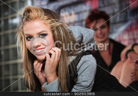 Beautiful Smiling Teen stock photo, Beautiful smiling Caucasian teenage girl in alley by Scott Griessel