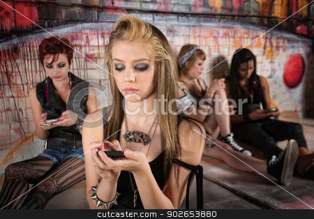 Girl Sending Text Messages stock photo, Serious young European girl looking at her phone by Scott Griessel