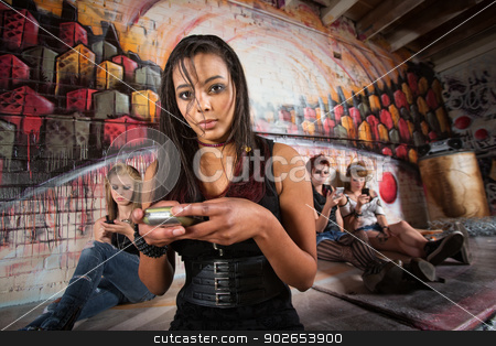 Serious Woman Using Phone stock photo, Serious African young woman holding cell phone by Scott Griessel