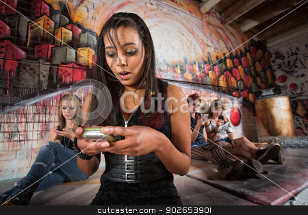 Lady Using Smart Phone stock photo, Cute mixed young woman using her cell phone by Scott Griessel