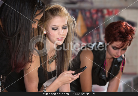 Pretty Girl Calling with Phone stock photo, Pretty teenage female making a call on her cellphone by Scott Griessel