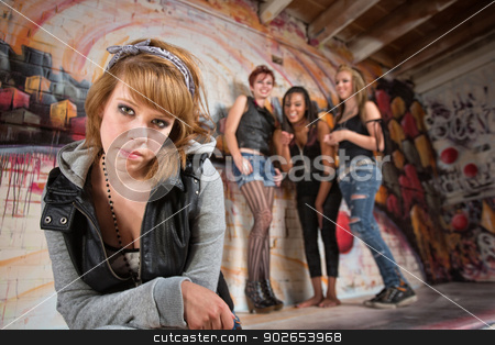 Bashful Girl Being Bullied stock photo, Bashful young woman being teased by group of teenagers by Scott Griessel