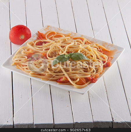 Pasta stock photo, A white plate full of linguine with tomato and basil by Fabio Alcini