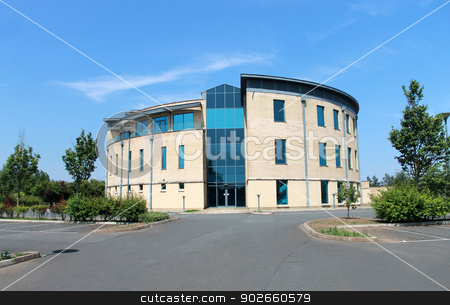 Modern office building stock photo, Exterior of modern office building with empty car park in foreground. by Martin Crowdy